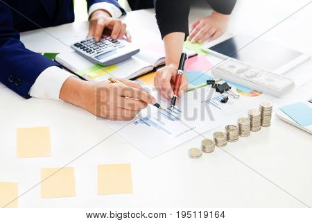 Business adviser analyzing financial. Financial planning Business man and Business woman talking to planner. financial business report finance in paper on office accounting.