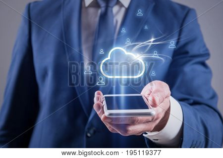 Data exchange concept. Close up of hand of businessman which is holding mobile phone and sharing information with contacts using connect to cloud network