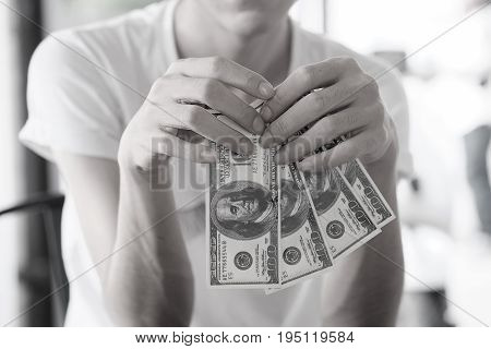 Human trafficking concept, A lady boy hand holding a money with vintage tone.