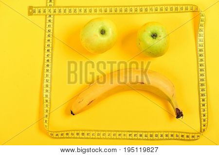 Banana And Green Apples Make Emoticon, Framed With Measuring Tape