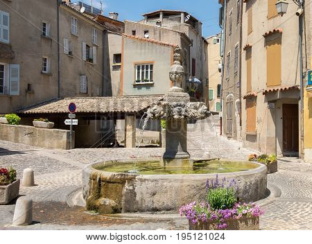 Fountain at central square in Valensole. Provence region. France