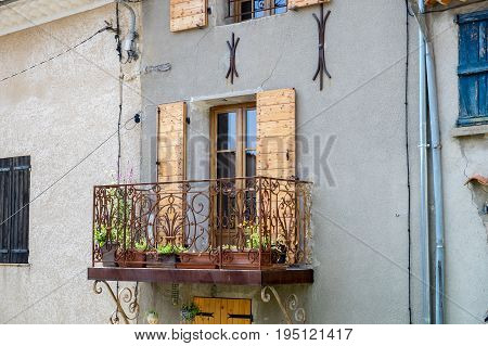 French Balcony With Flower Boxes In Provence. France