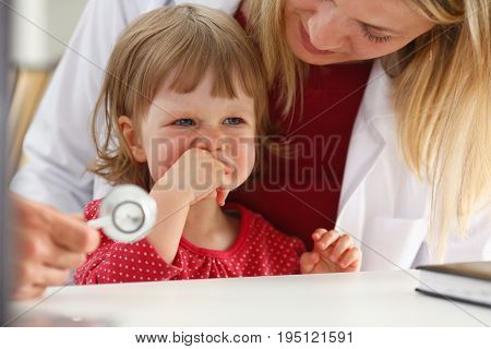 Little scared child at doctor reception make insulin shot. Physical exam cute baby aid healthy lifestyle child sickness specialist hepatitis hiv aids virus protection flu remedy drug concept