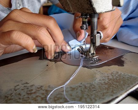 The Sewing and Industrial sewing machine in textile factory