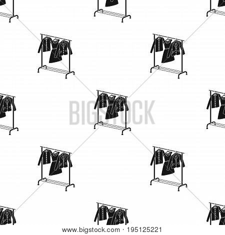 A hanger with things in the wardrobe.Making movie single icon in black style vector symbol stock illustration .