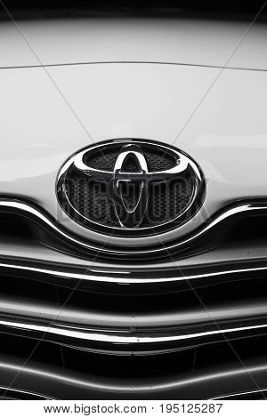 BANGKOK, THAILAND - JULY, 5 2017: Closeup of Toyota logo on Toyota Vios 2007 model as called in Thailand, one of the best seller compact sedan in Thailand