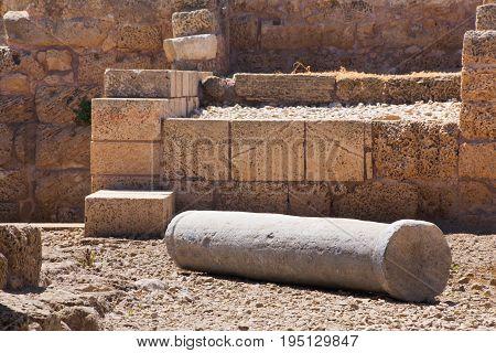 Roman falled stone pillar in cesarea Archaeological site close to Herod the Great hippodrome