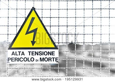 Italian Text on Triangle Yellow Metal sign and text means