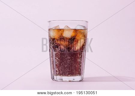 A cool glass of cola drink with ice