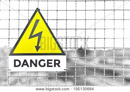Danger Text Triangle Metal sign at train deposit in italy editable text on white plate