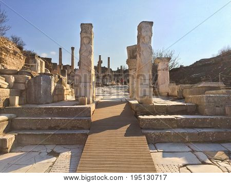 Apollo Roman Pillars at fallen Temple Door with statue decorated stone in ephesus Archaeological site in turkey