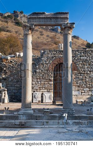 Classic White Roman Pillars at fallen Temple Door with statue decorated stone in ephesus Archaeological site in turkey