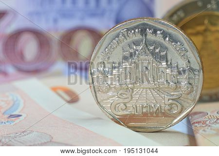 Thai money currency paper banknote and coin. For background or saving money or business and finance concept.