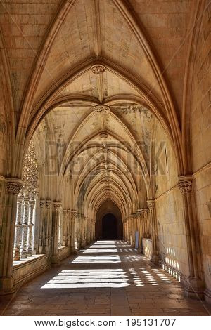 Batalha, Portugal - June 4, 2017: Cloister of the Monastery of Batalha. Monastery of Saint Mary of the Victory is one of the best examples of Late Gothic architecture in Portugal intermingled with the Manueline style