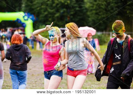 Kaliningrad Russia - July 08 2017: Young people are celebrating the Holi festival during the city day of Kaliningrad in rainy weather