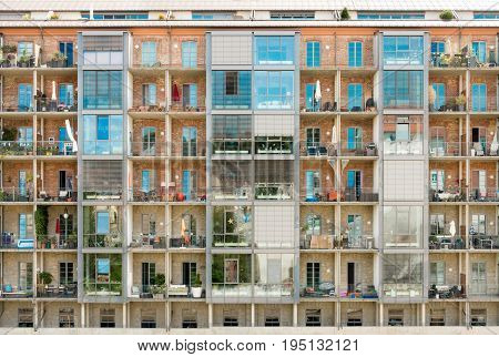 Modern renovated residential building with balconies. Former old historic industrial building. Germany.