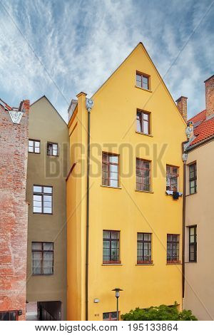 Facades Of Tenement Houses In Torun Old Town, Poland