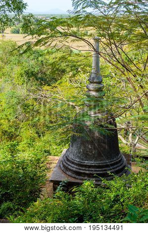 Buddhist Stupa In The Jungle Forest