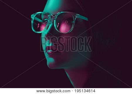 Headshot Of Stylish Young Woman In Sunglasses Looking Away