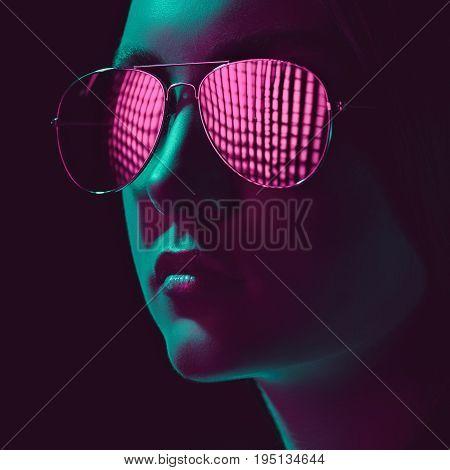 Headshot Of Stylish Young Woman In Sunglasses With Pink Lens