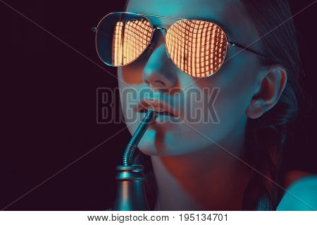 Woman In Sunglasses Drinking Soda From Water Bottle With Straw
