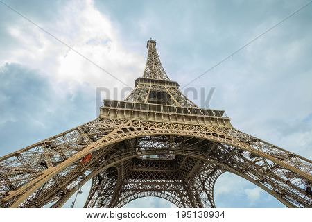 Prospective view of Tour Eiffel, symbol and icon of Paris. Bottom view of Eiffel Tower in the sky, Paris, France, Europe.