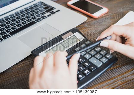 Morning Business Lady. Female Hands With A Pen And A Calculator, On Which A Million Is Counted. The