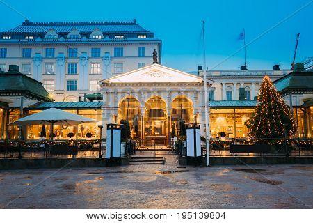 Helsinki, Finland. Famous And Popular Place Is Cafe, Bar, Restaurant On Esplanadi Park In Lighting At Evening Or Night Illumination.