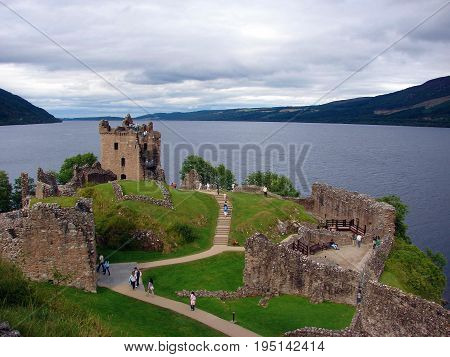 Urquhart Castle sits beside Loch Ness in the Highlands of Scotland