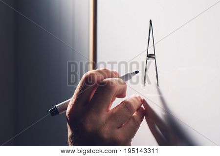 Adult illiteracy concept man learning to write letter A on whiteboard