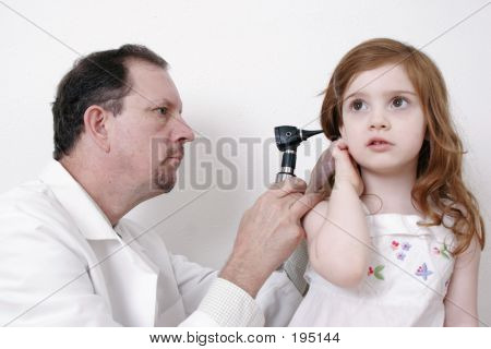 Doctor Checking Little Girl's Ear With A Stethoscope