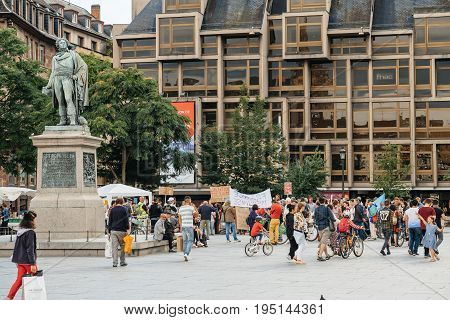 STRASBOURG FRANCE - JUL 12 2017: Protesters in Place Kleber as Melenchon called for day of protest against Macron government spending cuts and pro-business tax and labor reforms