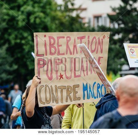 STRASBOURG FRANCE - JUL 12 2017: Large crowd of protesters in city as Melenchon called for day of protest against Macron government spending cuts and pro-business tax and labor reforms
