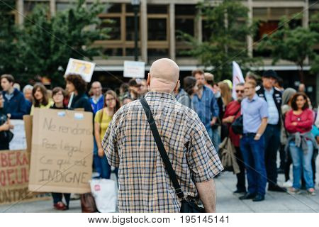 STRASBOURG FRANCE - JUL 12 2017: Man addressing to protesters in city as Melenchon called for day of protest against Macron government spending cuts and pro-business tax and labor reforms