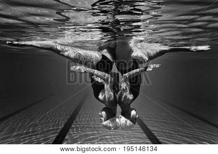 Synchronized Swimming Underwater, Black And White Image, Horizontal Image
