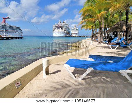 Cozumel Mexico - January 19 2017: cruise ships Hamony of the Seas and Carnival Glory docked at the port of Cozumel Mexico
