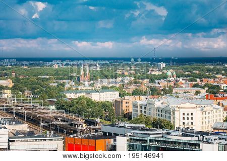 Riga, Latvia. Aerial Cityscape In Sunny Summer Day. Top View Of Landmarks - Riga Central Station, St. Francis Church, Ministry Of Transportation And All Saints Church.