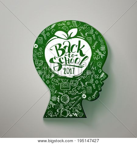Back to school hand drawn typography on head for chalkboard. Vector illustration. Kids face profile contour chalkboard with many doodle icons and apple with back to school on the profile