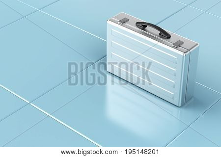 Silver briefcase on tile floor, 3D illustration