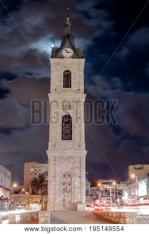 Tel Aviv -Yafo Israel July 08 2016: Old Clock Tower at night in old city Yafo Israel. It's limestone clock tower built in 1903 to honor one of the last sultans of the Ottoman Empire.