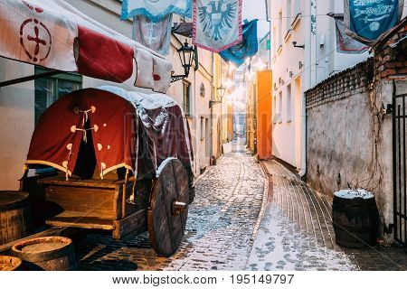 Riga, Latvia. Traditional Old Medieval Cart Is In Narrow Street Of Riga.