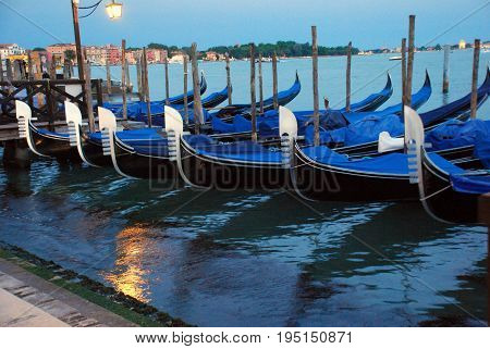 Romantic evening view of gondolas in Venice on the canals