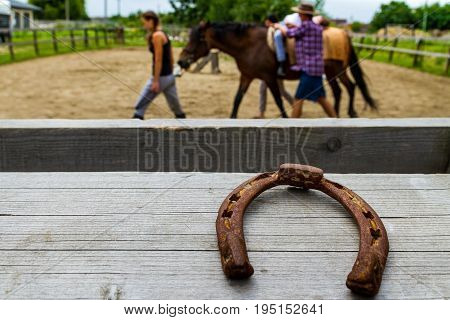 Vynohradiv Ukraine - July 12 2017: Horseshoe on fence racecourse in summer children's equestrian sports camp.