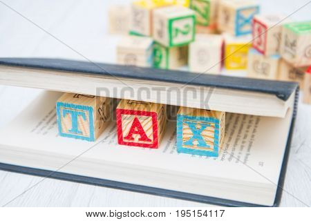 the tax written on wooden cubes on wood
