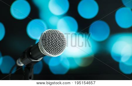 Microphone on abstract blurred of speech in seminar room or speaking conference hall light Event concert bokeh blue background