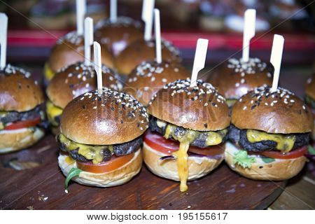 Delicious takeaway hamburgers waiting for guests . Shallow depth of field