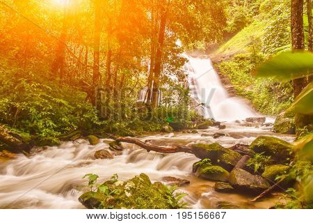 Huai Sai Lueang Waterfall with light lens flare in Doi Intanon national park pf Chiangmai Thailand.