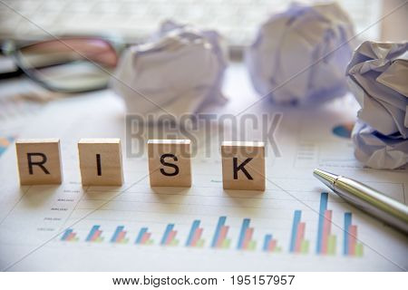 Words of business Risk concepts collected in crossword with wooden cubes. Business Concept