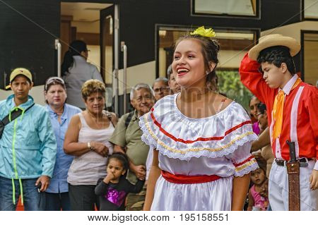 BUCAY, ECUADOR, OCTOBER - 2016 - Group of dancers and singers with typical costume dancing traditional ecuadorian music at Bucay city Ecuador