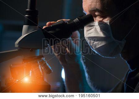 Doctor examines patient tissue samples